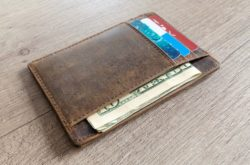 Close up of a full wallet from saving money