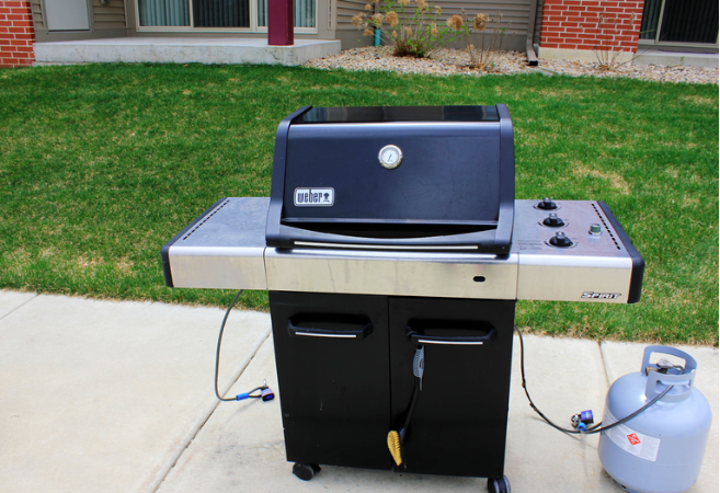 View of a propane grill sitting outside