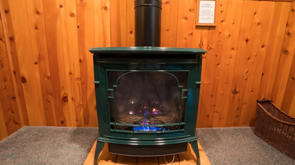 A nice looking propane stove keeping a house warm during the winter