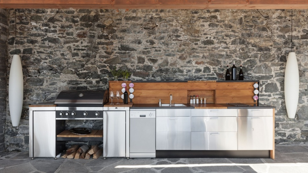 A beautiful outdoor kitchen complete with grill, sink, and countertops