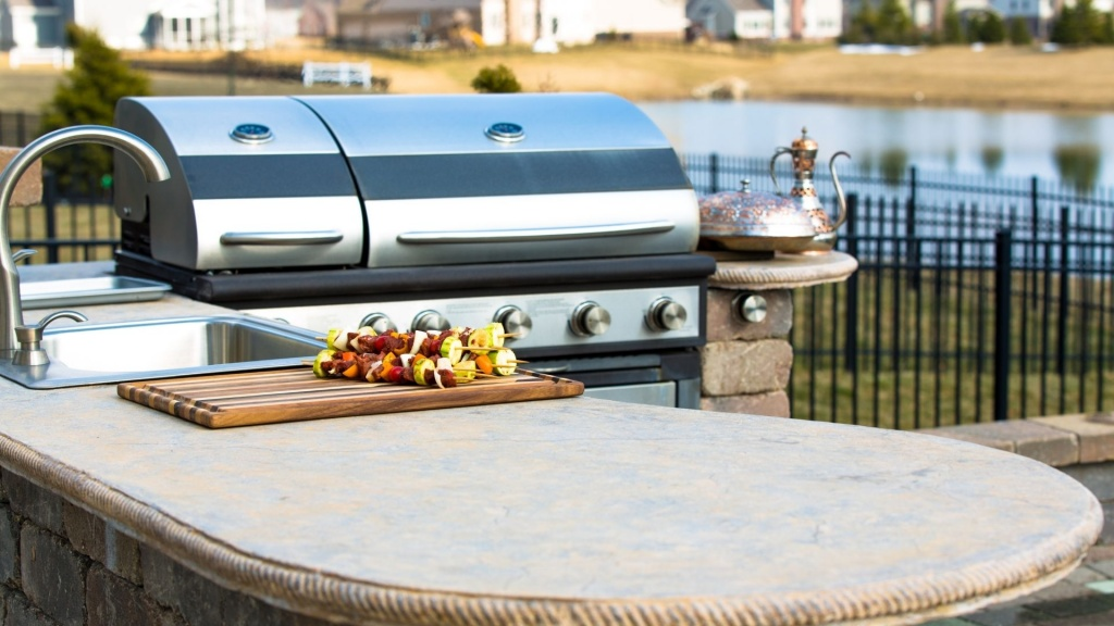 A beautiful pond side outdoor kitchen power by diversified