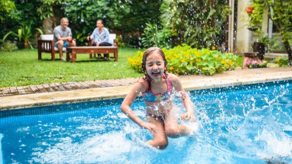 Kids having fun in a pool heated by propane